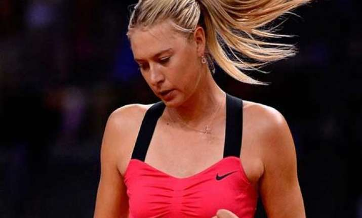 sharapova survives scare to progress at stuttgart