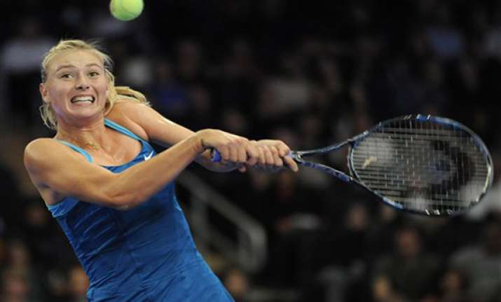 sharapova beats wozniacki in exhibition