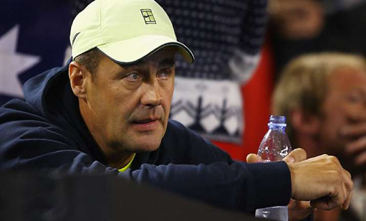 tomic s father banned by atp for alleged assault