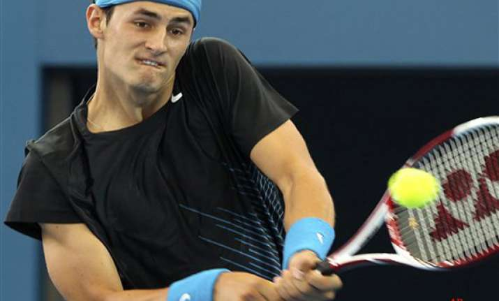 tomic into kooyong final with win over monfils
