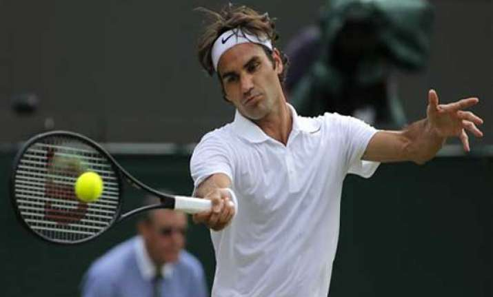 wimbledon federer back into quarterfinals for 12th time