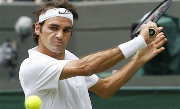 wimbledon roger federer shows no mercy in opener