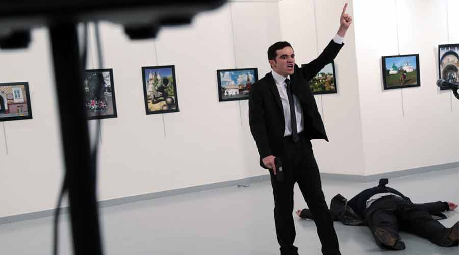 A man identified as Mevlut Mert Altintas shouts after shooting Andrei Karlov