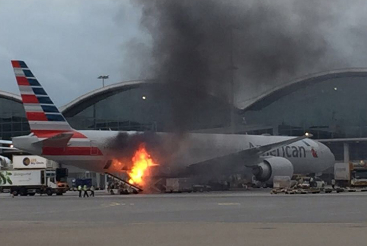 WATCH: American Airlines plane catches fire at Hong Kong
