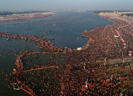 An aerial shot shows a sea of devotees gathered at Sangam