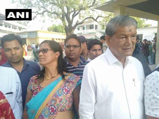 India Tv - HarishRawatqueues up inHaldwani to cast his vote