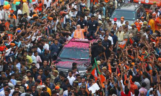 India Tv - Prime Minister Narendra Modi waves to the crowd during a political campaign road show in Varanasi, India, Thursday, April 25, 2019