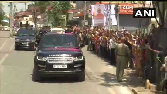 India Tv - People gather to catch a glimpse of PM Modi
