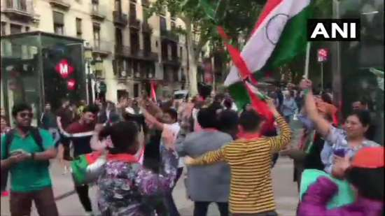 India Tv - BJP supporters celebrate in Spain