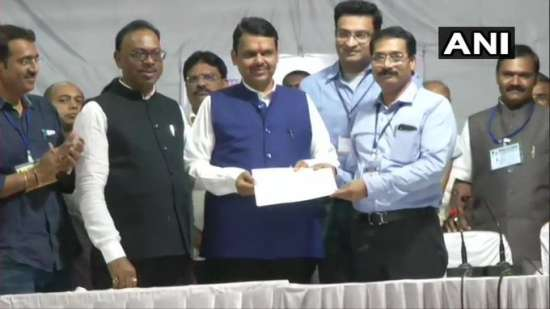 India Tv - Maharashtra CM Devendra Fadnavis with elections officers