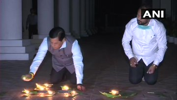 India Tv - Assam Chief Minister Sarbananda Sonowal lights eat