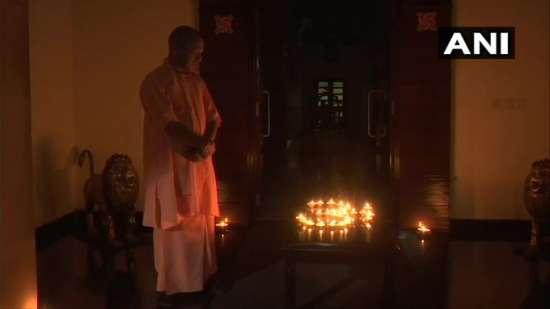 India Tv - Adityanath lights earthen lamps to mark India's fi