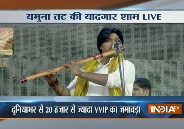 India Tv - Artist playing flute