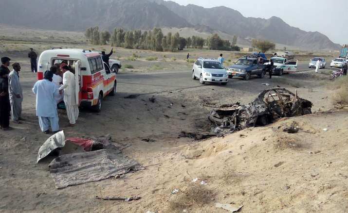 India Tv - volunteers near wreckage of vehicle, in which Mullah Mansour was travelling