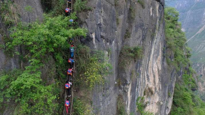 Children climb 2,500 foot ladder to go to school
