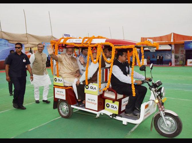 PM Modi riding an E-rickshaw