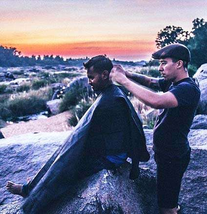 India Tv - The Nomad Barber travelling through Hampi in India