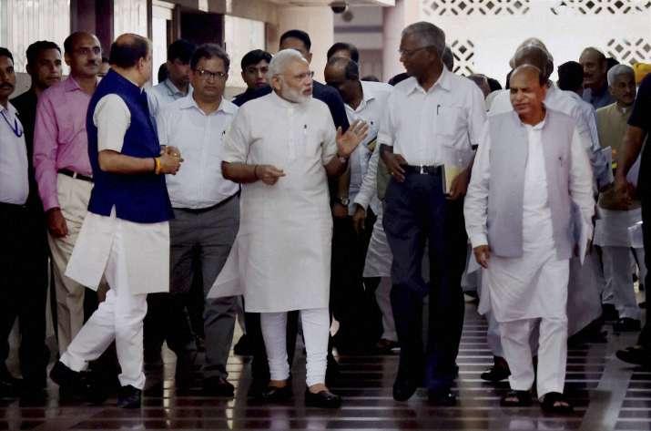 India Tv - Prime Minister Narendra Modi with NCP Leader D P Tripathi and CPI leader D Raja.