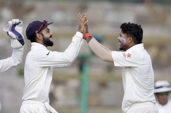 Virat Kohli with Umesh Yadav