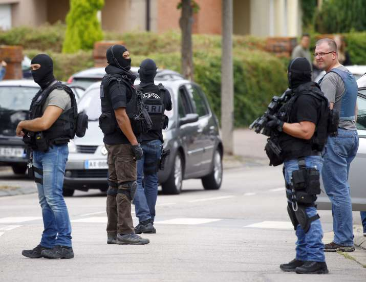 Security personnel at the sight of Normandy church attack