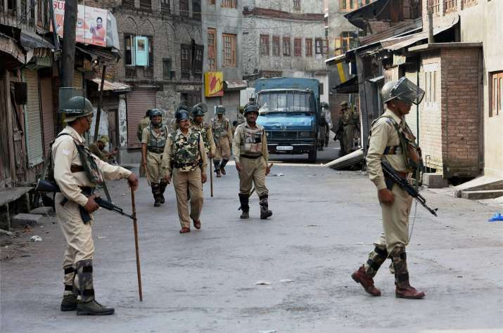 CRPF jawans patrolling a street during restrictions and