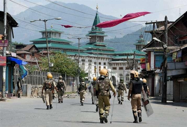 CRPF Jawans patrolling a street in Srinagar