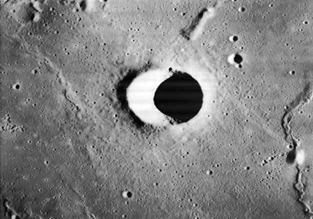 India Tv - A lunar crater photographed by Lunar Orbiter 1.