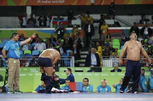 Rio 2016 Mongolian wrestling coaches strip off clothes to