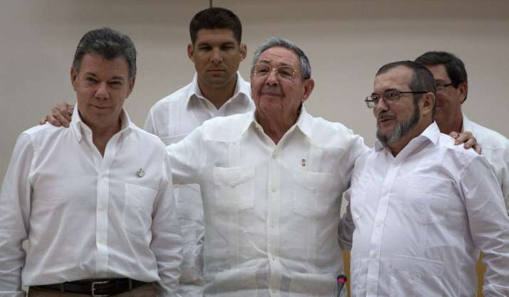 Cuba's President Raul Castro, center, stands with Colombian
