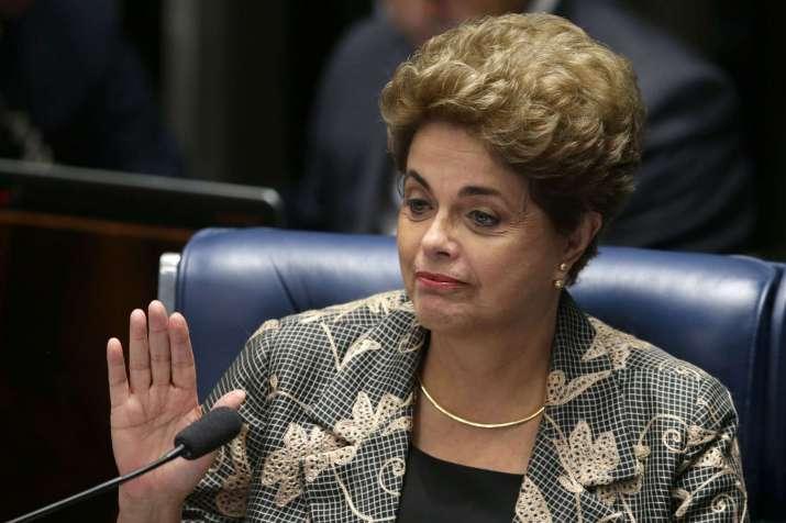 Suspended Brazilian President Dilma Rousseff waves goodbye