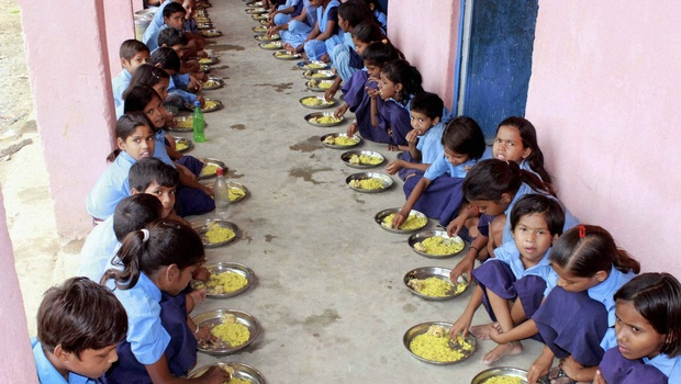 Children eating mid-day meal at a school
