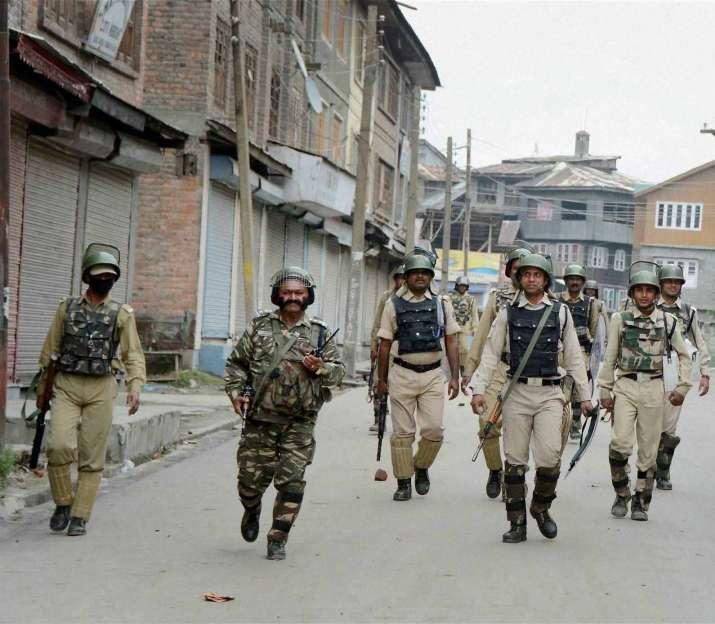 Security personnel during vigil in Kashmir