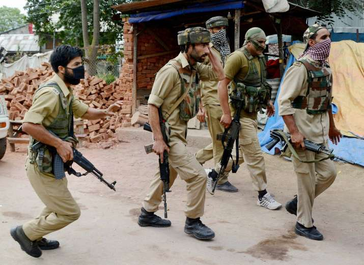 SoG of Jammu and Kashmir Police take position during an