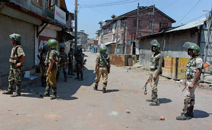Security personnel stand guard in street during 41st day of