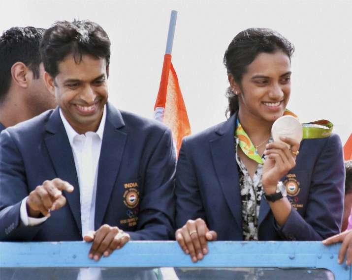 India Tv - PV Sindhu and P. Gopichand   India TV