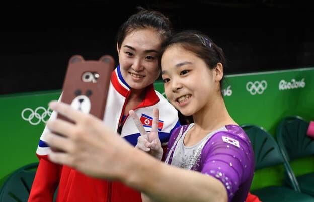 India Tv - South Korean and North Korean athletes