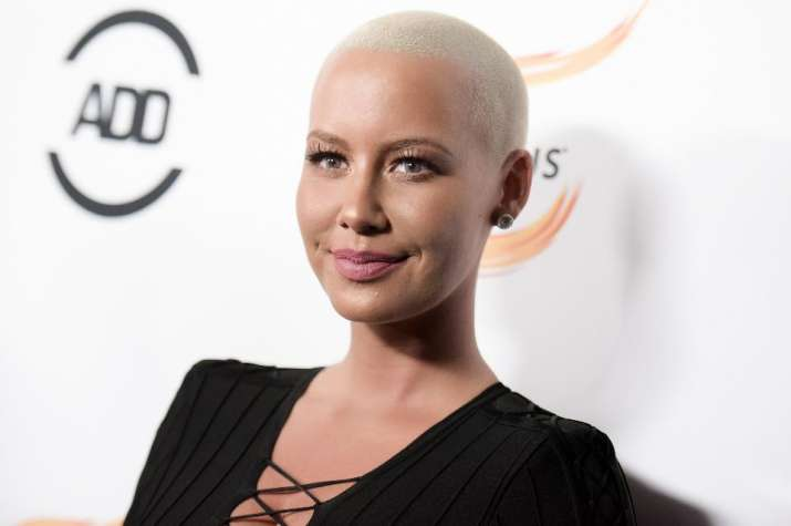 Amber Rose poses topless