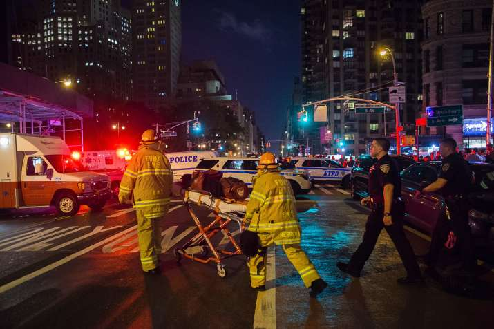 India Tv - Police and firefighters work near the scene of blast in Manhattan's Chelsea