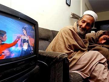 Pak man watching television