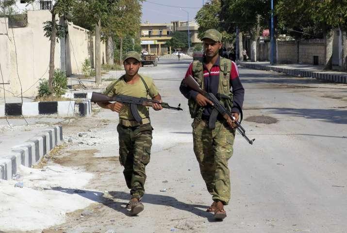 FILE: Free Syrian Army fighters patrol in Jarablus, Syria