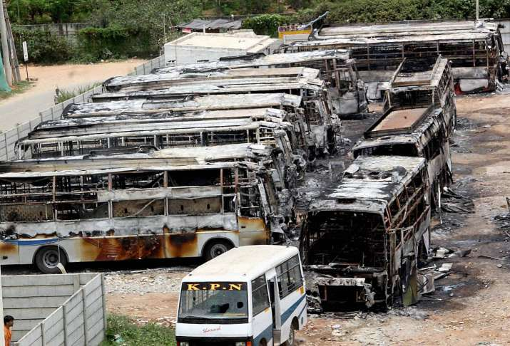 Bengaluru: Charred remains of buses burned during a protest