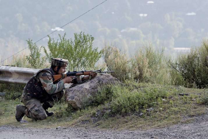 A soldier takes position near Army Brigade camp during a