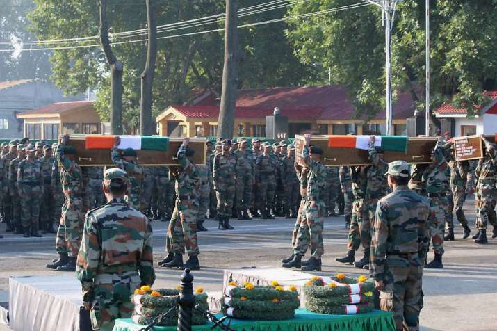 Army jawans carrying the coffins of their colleagues killed