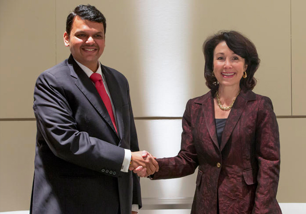 Oracle CEO Safra Catz shakes hands with Devendra Fadnavis