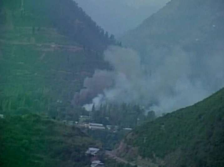 India Tv - Cloud of smoke after explosion at Army camp in Uri