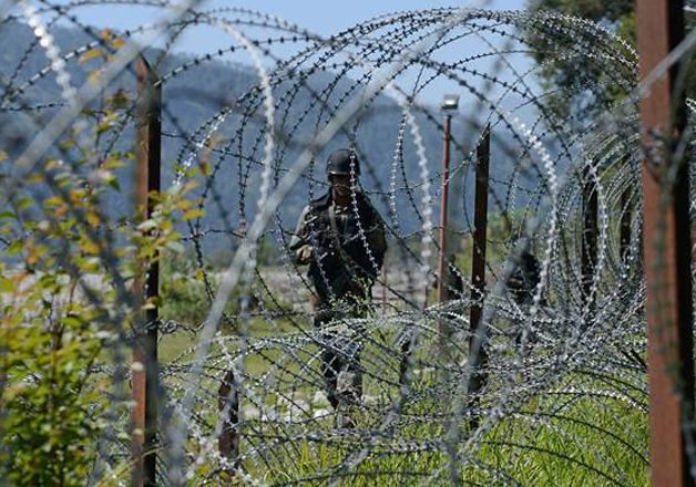 A file photo of an Indian Army soldier patroling along the