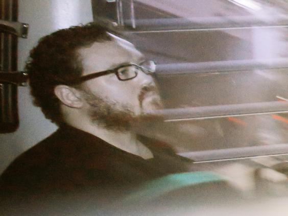 Rurik Jutting, a British banker, sitting in a prison bus