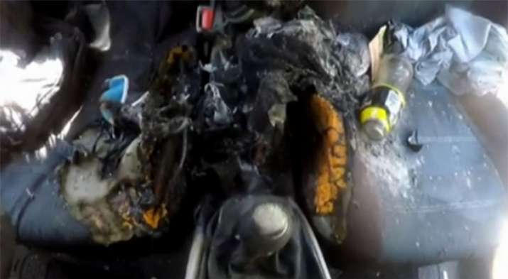 India Tv - What is left of car's center console: