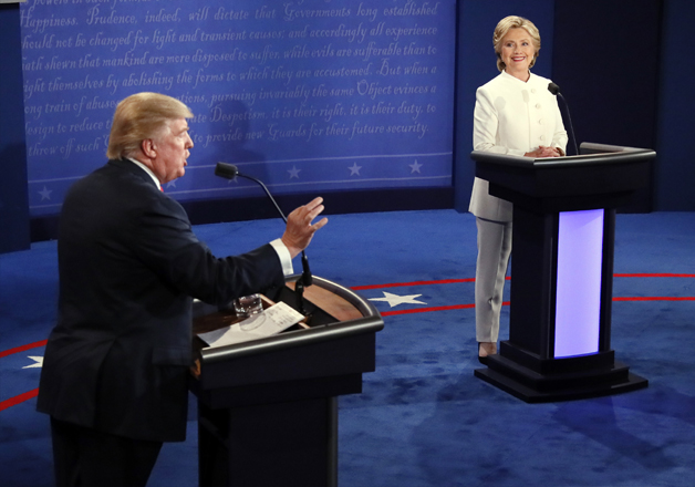 Donald Trump debates Hillary Clinton during the third