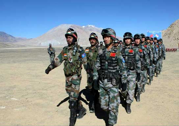Indian and Chinese soldiers participate in a drill in
